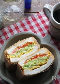 『バター蒸しキャベツの卵包み極厚サンド。1個でお野菜100g!』