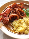 魚介トマトのサフラン煮込み(クスクス添え)